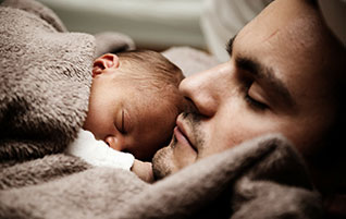 Father holding infant