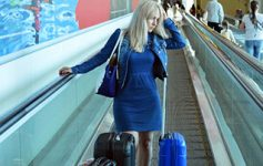 Are You Heaven-bound? Woman at Airport