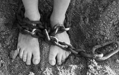 Obedience breaks chains. (Image: Person with feet in chains)