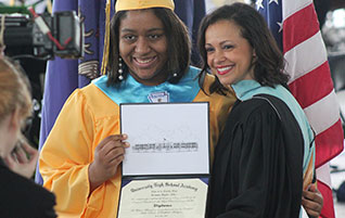 Graduates: Prepare for Finals (Image: Student graduating in cap and gown)