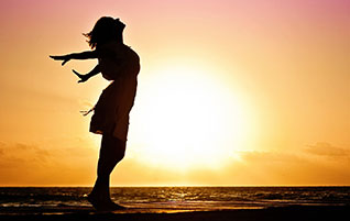 The Gospel Jesus Preached: Grace leads to a transformed life. (Image: Woman at Sunrise)